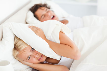 A woman who can't sleep because of her husband's snoring